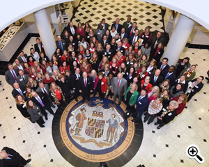 Pictured: Tourism Advocates gathered in the Rotunda of the Michael Miller Senate Building