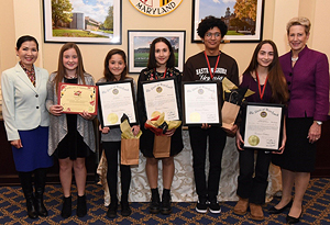 Pictured: (Left to Right) First Lady Yumi Hogan, student artist Sara Miles;Elementary School First Place Winner Lucia Owens of Calvert County; Middle School First Place Winner Noor Chehab of Montgomery County; High School First Place Winner Tony Herrera of Wicomico County; High School First Place Winner Rebeca Fuquen of Anne Arundel County; and Dr. Karen B. Salmon State Superintendent of Schools.