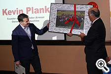 Commerce Secretary Mike Gill presented Under Armour CEO Kevin Plank with a framed, signed photo of the Maryland Department of Commerce team.