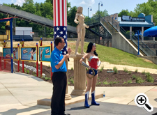 Six Flags America park president Rick Howarth is joined by Wonder Woman to officially open the new ride.