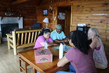 Family staying at a full service rental cabin at Janes Island State Park along the Chesapeake Country Scenic Byway.
