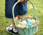 Child carrying an Easter Basket