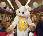 Children enjoying the Easter Bunny on a train ride