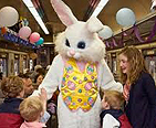 Picture of the Easter Bunny on a train with kids and family.