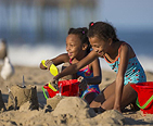 Girls building sand castles on the beach