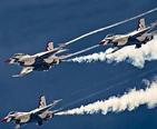 Three USAF Thunderbirds performing a stunt.
