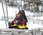 Two girls riding the Mountain Coaster at Wisp together