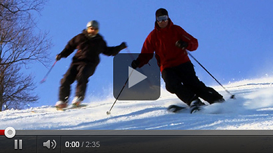 Two men skiing