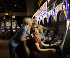 Family playing a slot machine at a Maryland Casino