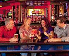 Four people having a drink at the Ocean Downs Casino in Ocean City