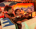 Girls riding a ride together at a County Fair