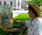 Lady Painting during a Plein Air Event.