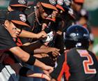 Baltimore Orioles Players congratulating Cal Ripken for his home run.