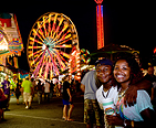 Young couple enjoying the fair together