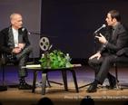 Waters being interviewed by John Travolta