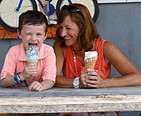 Mother and son enjoying an ice cream cone