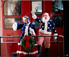 Mr and Mrs Claus entering by train