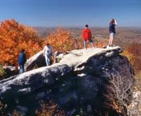 People rock climbing and enjoying the Fall Foliage in Western Maryland