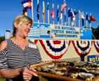 Lady shucking oysters at the U.S. Oyster Festival in St. Mary's