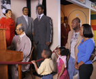 A family visiting the National Great Blacks In Wax Museum in Baltimore.
